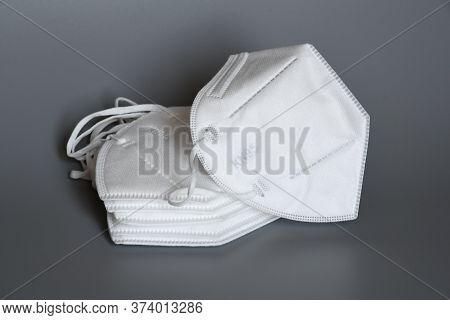 White Kn95 Or N95 Mask For Protection Pm 2.5 And Corona Virus Isolated On Grey Background. Preventio