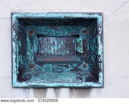 An Old Metal Outdoor Overnight Deposit Box Also Known As A Night Safe, Once Common On The Outside Wa