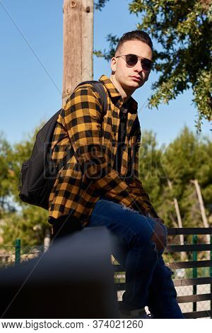 Urban Style Guy Poses Looking At Camera. Lifestyle Concept, Reggaeton Music