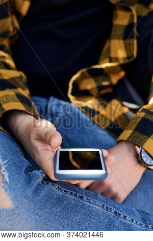Close Up Of A Guy Using His Smartphone Outside. Lifestyle, Technology