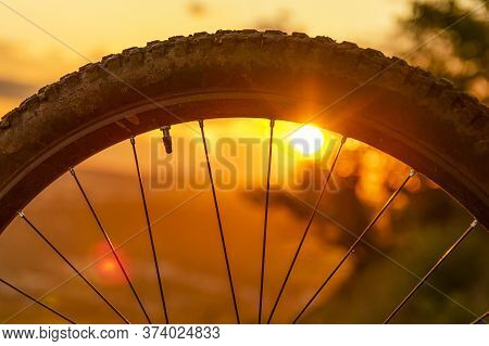 Detail Of A Mountain Bike Wheel At Sunset. Close-up Of Bicycle Tire. Enduro, Downhill, Cross Country