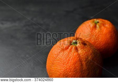 Mandarin Organic Fruits On Black Background. Copy Space.