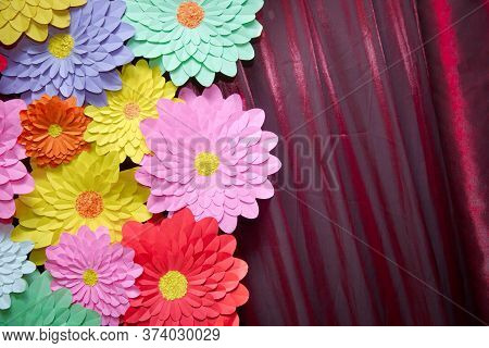 Paper Flower. Glade Of Multi-colored Flowers. Red Curtain Background . Valentines Day. Flowers Of Pa