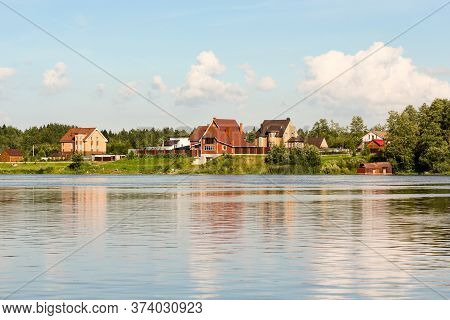 Cottage Village On The Shore. Nature On The Banks Of The Volkhov River.