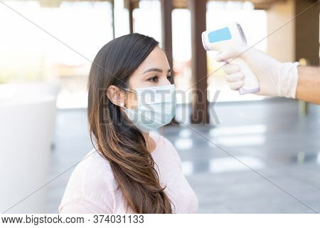 Caucasian Mid Adult Woman Going Through Thermal Scanning Test In City