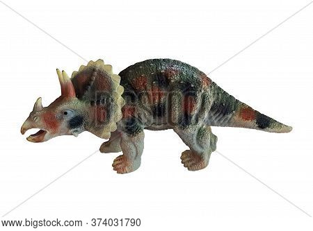 There Is A Toy Dinosaurs Triceratops. White Background. Isolated.