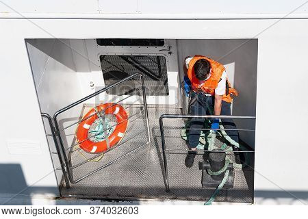 Sailor Of The River Ship. The Work Of A Sailor During The Mooring Of The Ship. Profession Sailor Ple