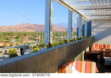 June 22, 2020 In Palm Springs, Ca:  Modern Style Patio Furniture Besides A Ledge With A Manicured Ga
