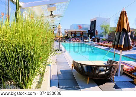 June 22, 2020 In Palm Springs, Ca:  Lush Manicured Plants Besides A Rooftop Pool Surrounded By Patio