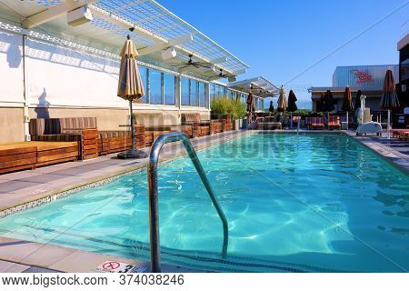 June 22, 2020 In Palm Springs, Ca:  Modern Style Seating Besides A Rooftop Pool Taken At The Kimpton
