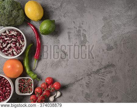 Organic Vegetables, Beans And On Grey Background.
