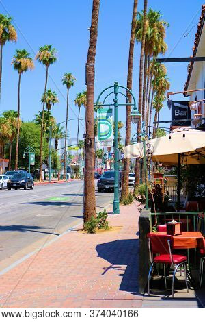June 22, 2020 In Palm Springs, Ca:  Outdoor Seating At A Restaurant Overlooking A Main Downtown Stre
