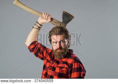 Bearded Man With Old Ax. Bearded Man With Old Ax In Hands. Bearded Lumberjack. Close Up Portrait Of