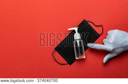 Washing Hands Isolated On Red. Using Medical Sanitizer Gel In Lab Gloves On Red Background. Clear Sa