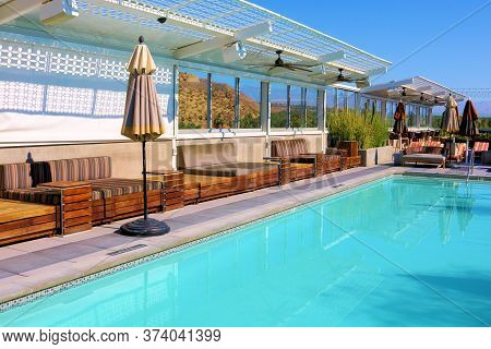 June 22, 2020 In Palm Springs, Ca:  Contemporary Style Furniture, Surrounding A Rooftop Pool Taken A