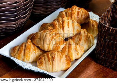 Fresh Baked Croissants. Warm Fresh Buttery Croissants and Rolls. French and American Croissants and Baked Pastries are enjoyed