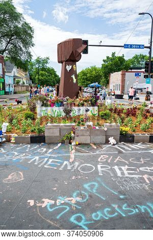Mpls, Mn/usa - June 21, 2020: Raised Fist Memorial On Street Corner Site Of George Floyd's Arrest An