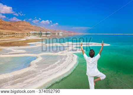 Very salty water glows with turquoise light. The concept of ecological and medical tourism. The evaporated salt has developed into fantastic patterns