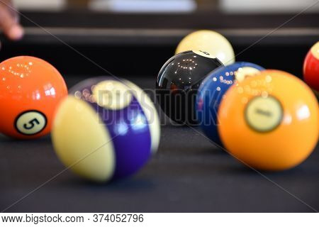 Black Billiard Table, Billiard Balls In A Pool Table, Out Of Focus Balls