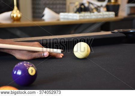 Black Billiard Table, Playing Billiard - Close-up Shot Of A Man Playing Billiard