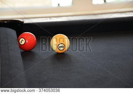 Black Billiard Table, Billiard Balls In A Pool Table, Focused On 9 Ball