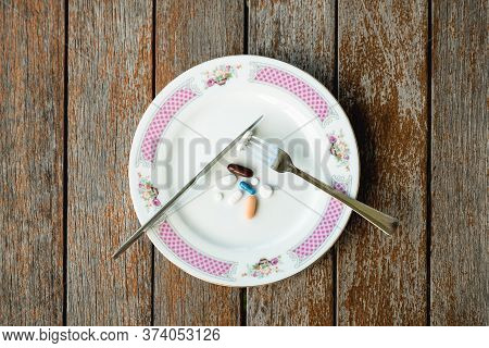 Pills / Drugs Served On A Plate With Knife And Fork