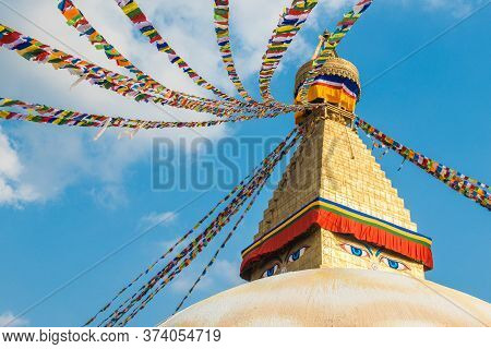 The Buddhist Prayer Flags Blowing In The Wind By Hanging On The Tiered Of Boudhanath Stupa The Large