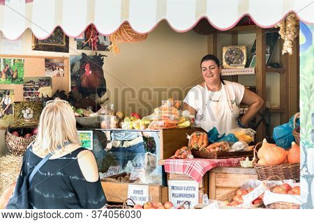Croatia, Split - September 22th, 2018: A Female Seller Speaking With Happiness With A Customer At He