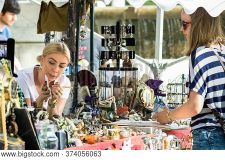 Croatia, Split - September 22th, 2018: A Female Seller Discussing The Price With A Customer At An An
