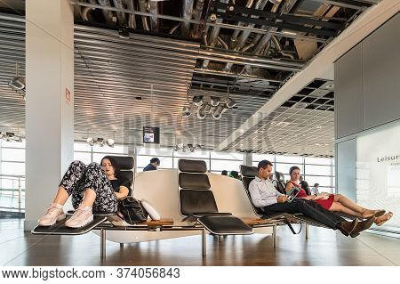Frankfurt, Germany - July 3th, 2018: Passengers Resting In Recliner Seats In The Waiting Hall At Fra