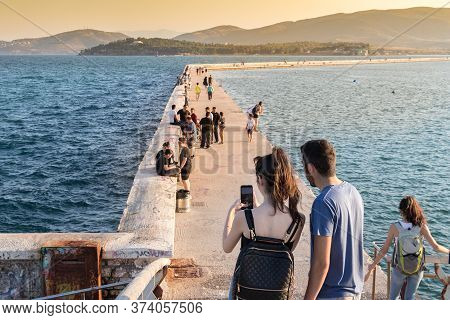 Volos, Thessaly, Greece - May 27th, 2018: A Young Couple Standing Taking Photos With A Mobile On A L