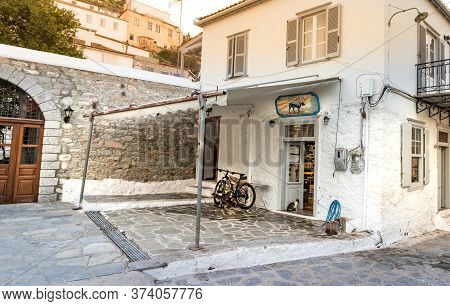 Hydra, Greece - October 4th, 2018: A Traditional Old Store - Mini Market With A Wooden Signboard In