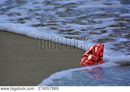 On The Sand  With Red Gems  Placed, Looks Beautiful And Valuable