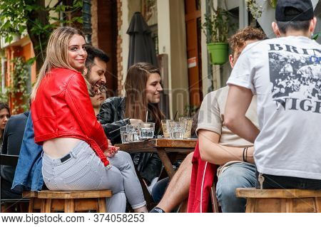 Larissa, Thessaly, Greece - May 4th, 2018: Blond Woman Sitting With Friends Havings Drinks At Monk C