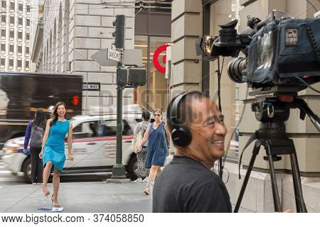 San Francisco, Usa - September 13th, 2017: A Femal Asian Tv Reporter Is Laughing With The Cameraman