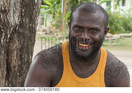 Gizo, Solomon Island - March 11th, 2017:portrait Of A Melanesian Man With Red Lips And Teeth Because