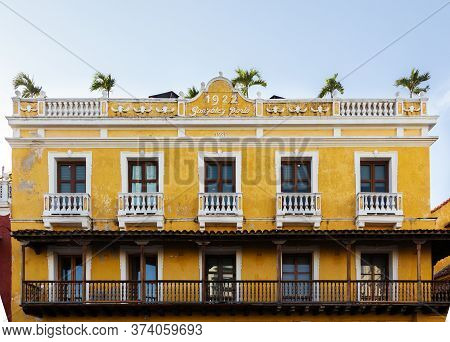 Cartagena, Colombia - January 23th, 2018: Facade Of The Hotel Del Reloj Colonial Style Yellow Color