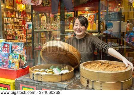 Nagasaki, Japan - March 26th, 2017: A Chinese Vendor Selling Steamed Pork Buns On The Street At The