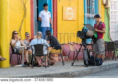 Cartagena, Colombia - January 23th, 2018: A Cameraman Reading A Menu At The Solar Bar, Colonial Styl