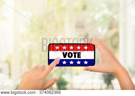 Online Election And Us Election Concept : Hand Holding Smartphone And Pressing Vote Text On Smartpho