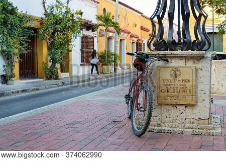 Cartagena, Colombia - January 23th, 2018: A Bike At The Water Cistern Of Plazoleta Del Pozo At The G