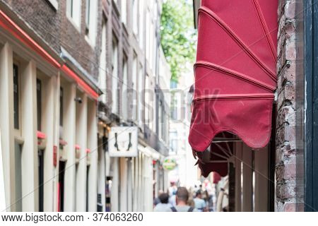 Amsterdam, Netherlands - July 21th, 2018: A Red Storefront Awning At The The Red District In Amsterd