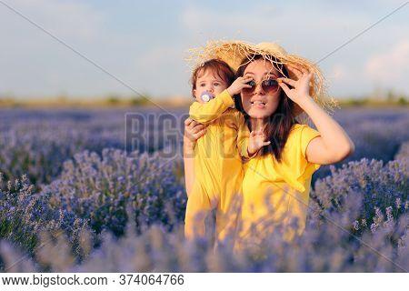 Baby Grabbing Mom Sunglasses In Beautiful Lavender Field