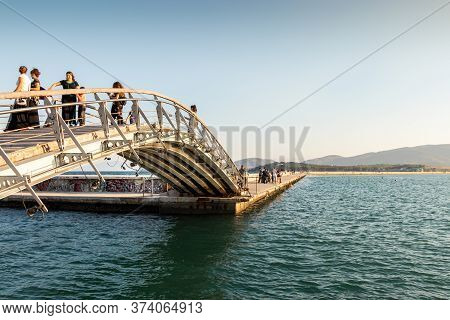 Volos, Thessaly, Greece - May 27th, 2018: People Walking At A Little Bridge At The Port Of Volos, Pa
