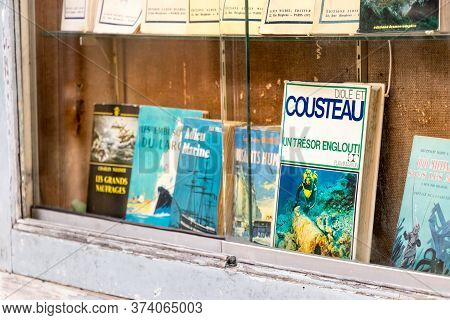 Saint - Malo, France - July 16th, 2018: A Jacques Cousteau Old Book At The Traditional Library Septe
