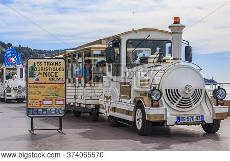 Nice, France - April 20, 2016: Tourist Train Waiting For Passengers By The Beach On Promenade Des An