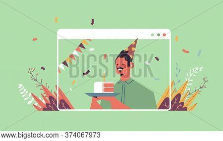 Man In Funny Festive Hat Celebrating Online Birthday Party Happy Guy In Computer Window Holding Cake