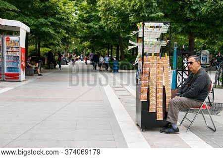 Larissa, Thessaly, Greece - May 4th, 2018: A Man Sitting Selling Lottery Tickets At The Kentriki Pla
