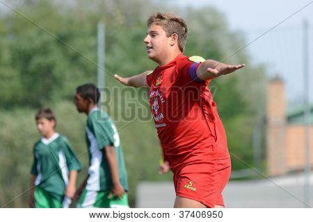 KAPOSVAR, HUNGARY - SEPTEMBER 22: Unidentified player celebrate at the Hungarian Championship under 15 game between Rakoczi (green) and Mezga FC (red) September 22, 2012 in Kaposvar, Hungary.