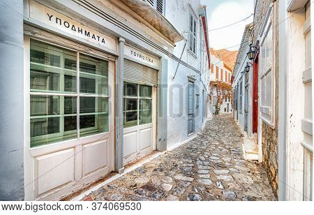 Hydra, Greece - October 4th, 2018: A Traditional Footwear Tourism Old Store With A Wooden Signboard